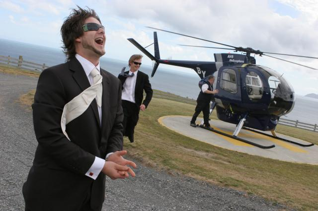 Groom arrives by Helicopter, Pencarrow Lodge
